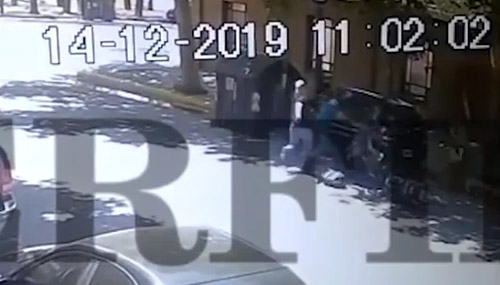 Shocking footage shows one of the men being shot on the street