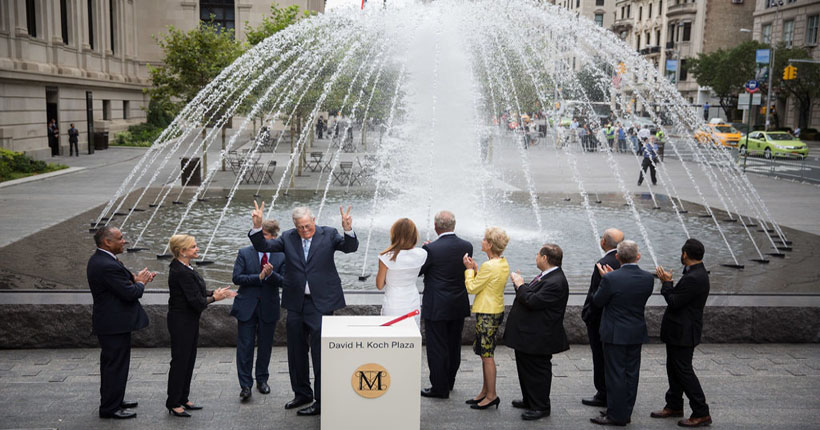 David Koch flashed a victory sign at the opening of the David Koch Plaza at the Metropolitan Museum of Art in 2014. He had given $65 million for its restoration. Damon Winter/The New York Times