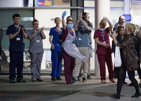 NHS workers at Royal Liverpool University Hospital also join in the round of applauseCredit: PA: Press Association