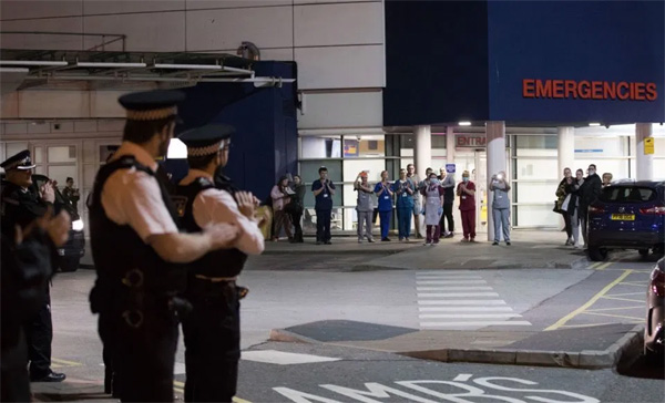 Police patrolling Royal Liverpool University Hospital show their support Credit: Press Association