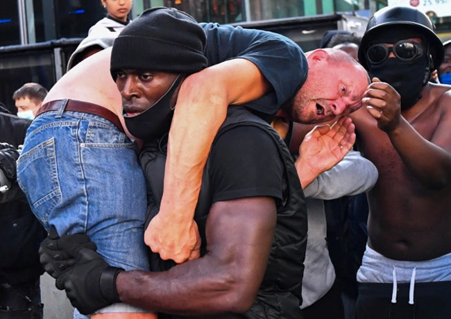The BLM supporter carried the injured man from an opposing group to safety.