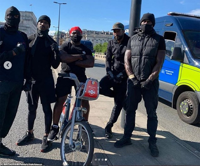 Personal trainer Patrick Hutchinson (right) has taken to social media to claim he was the man who had helped the opposition protester, telling his thousands of followers 'We saved a life today'