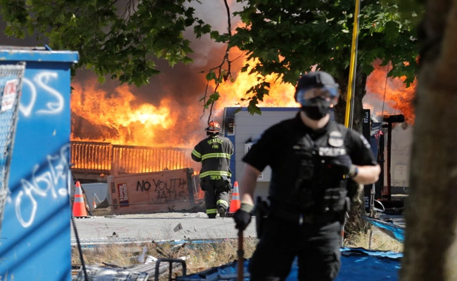 Rioters also torched a youth detention center and police precint in Seattle